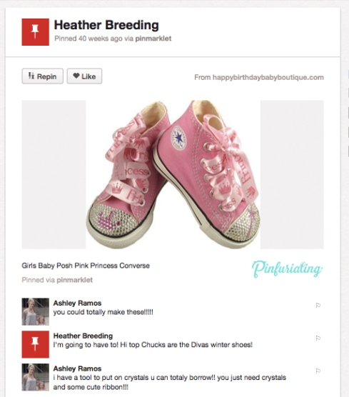 A picture of pink baby converse shoes, covered in rhinestones.