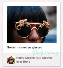 A pair of gold sunglasses with golden metal monkeys perched on the top of the rims on each side.