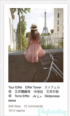 An image of a girl in a flower dress and straw hat looking at the eiffel tower beside her grandma handlebars bike.