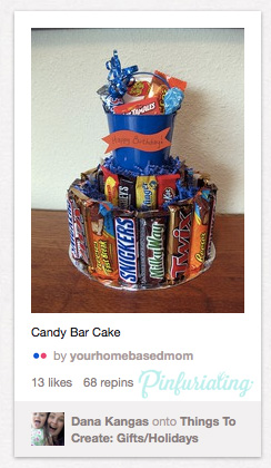 An image of a birthday cake made out of candy bars, still in their wrappers.