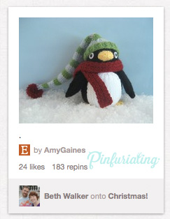 A pin of pingu in a hat and scarf, a crochet version.