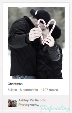 A photo of a couple in black and white, kissing, framed by two coloured red and white candy canes that they're holding out, shaped like a heart.