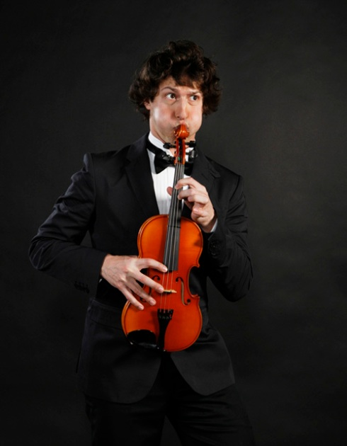 Andy Samberg from SNL playing a violin like a saxophone.
