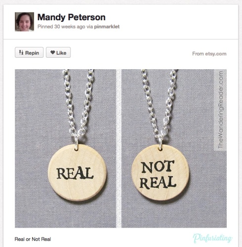 Two necklaces inspired by the hunger games, one reading real, and one reading not real. Real or not real.